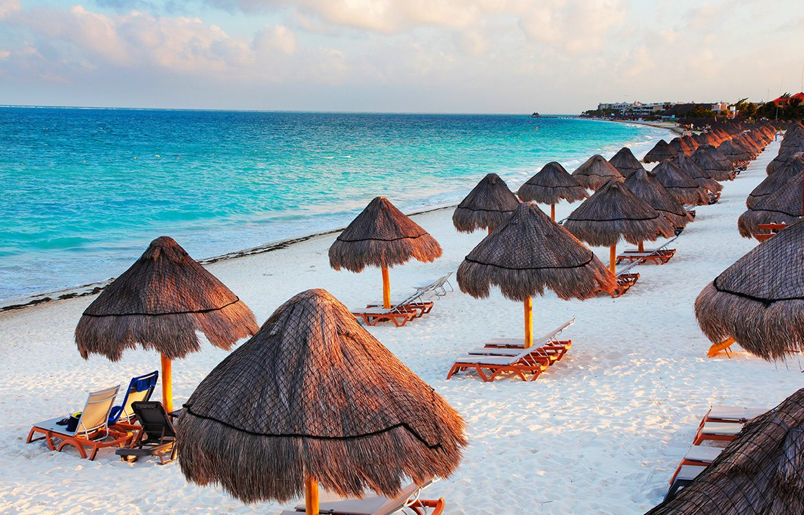 cancun-gallery-beach-umbrella-sunbathing
